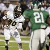 James Flanders (20) of Midwest City runs for a touchdown in the second quarter during a high school football game between Midwest City and Edmond Santa Fe at Wantland Stadium in Edmond, Okla., Thursday, Sept. 15, 2011. Photo by Nate Billings, The Oklahoman
