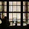 Photo - A member waves to friends in front of the stained glass windows before the start of the last service at First Baptist Church of El Reno Sunday, September 8, 2013. Photo by Doug Hoke, The Oklahoman