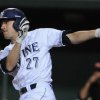 Photo - UC Irvine's Grant Palmer drives in a run against Oregon State during an NCAA college baseball regional tournament game in Corvallis, Ore., Monday, June 2, 2014. (AP Photo/Mark Ylen)