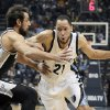 Photo - Memphis Grizzlies' Tayshaun Prince (21) dribbles the ball past San Antonio Spurs' Marco Belinelli, of Italy, left, in the first half of an NBA basketball game in Memphis, Tenn., Friday, Nov. 22, 2013. (AP Photo/Danny Johnston)