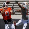 OSU\'s Charlie Moore catches a touchdown pass in front of OSU\'s Miketavius Jones during Oklahoma State\'s spring football game at Boone Pickens Stadium in Stillwater, Okla., Saturday, April 21, 2012. Photo by Bryan Terry, The Oklahoman