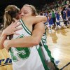 Adair\'s Tamara Harris (12) hugs Kevi Luper (15), left, after the Class 3A girls championship game between Millwood and Adair in the Oklahoma High School Basketball Championships at State Fair Arena in Oklahoma City, Saturday, March 14, 2009. Adair won, 63-47. PHOTO BY NATE BILLINGS, THE OKLAHOMAN