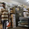 In this Dec. 10, 2012 photo, a man stands amid piles of documents of land records inside a room at the government registrar\'s office in Hoskote 30 Kilometers (19 miles) from Bangalore in southern Indian state of Karnataka. For years, Karnataka\'s land records were a quagmire of disputed, forged documents maintained by thousands of tyrannical bureaucrats who demanded bribes to do their jobs. In 2002, there were hopes that this was about to change. (AP Photo/Aijaz Rahi)