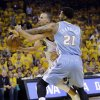 Golden State Warriors\' Stephen Curry, left, is fouled going to the basket by Denver Nuggets\' Wilson Chandler (21) during the first half of Game 6 in a first-round NBA basketball playoff series in Oakland, Calif., Thursday, May 2, 2013. (AP Photo/Marcio Jose Sanchez)