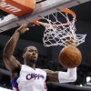 Los Angeles Clippers center DeAndre Jordan dunks against the Oklahoma City Thunder during the first half of an NBA basketball game in Los Angeles, Monday, Jan. 30, 2012. (AP Photo/Chris Carlson)