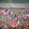 Photo - FILE - In this July 28, 2010 file photo provided by the Department of Defense, thousands of Boy Scouts march with flags for the playing of the national anthem during the Boy Scouts of America's 2010 National Jamboree at Ft. AP Hill, Va. The Boy Scouts of America announced Monday, Jan. 28, 2013, that it was considering replacing its long-standing ban on gays with a policy that would let troop sponsors make their own decisions. (AP Photo/Department of Defense, Cherie Cullen, File)