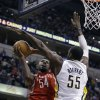 Photo - Houston Rockets' Patrick Patterson (54) puts up a shot against Indiana Pacers' Roy Hibbert during the first half of an NBA basketball game Friday, Jan. 18, 2013, in Indianapolis. (AP Photo/Darron Cummings)