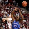 Kansas\' Chelsea Gardner (15) grabs a rebound from Oklahoma\'s Whitney Hand (25) during the women\'s college basketball game between the Oklahoma Sooners and the Kansas Jayhawks at the LLoyd Noble Center in Norman, Okla., Sunday, March, 4, 2011. Photo by Sarah Phipps, The Oklahoman