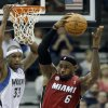 Miami Heat\'s LeBron James, right, beats Minnesota Timberwolves\' Dante Cunningham in the second half of an NBA basketball game for one of his 10 rebounds Monday, March 4, 2013, in Minneapolis. The Heat won 97-81. (AP Photo/Jim Mone)