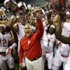 Photo - Rutgers head coach Kyle Flood, center, celebrates with his team after they beat Washington State 41-38 in an NCAA college football game, Thursday, Aug. 28, 2014, in Seattle. (AP Photo/Ted S. Warren)