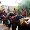 Photo - FILE - This file image posted on a militant website on Saturday, June 14, 2014, which has been verified and is consistent with other AP reporting, appears to show militants from the al-Qaida-inspired Islamic State of Iraq and the Levant leading away captured Iraqi soldiers dressed in plain clothes after taking over a base in Tikrit, Iraq. Iraq's military has been deeply shaken by their humiliating collapse in the face of an onslaught by Islamic militants the past two weeks. Officers talk of hardly being able to live with the shame. Commanders are under investigation for abandoning their posts. The impact is hurting efforts to rally the armed forces to fight back, with Shiite militiamen filling the void. (AP Photo via militant website, File)