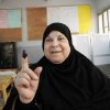 An Egyptian woman shows her inked finger after casting her vote inside a polling station, in Giza, Egypt, Wednesday, May 23, 2012. More than 15 months after autocratic leader Hosni Mubarak\'s ouster, Egyptians streamed to polling stations Wednesday to freely choose a president for the first time in generations. (AP Photo/Mohammed Asad) ORG XMIT: CAI114