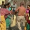 In this image taken from video obtained from Network 1 News and Information Syndicate (NNIS), which has been authenticated based on its contents and other AP reporting, Bikram Singh Brahma, center, a leader of India\'s ruling Congress party, has his shirt torn off by women in the village of Santipur, India, on Thursday, Jan. 3, 2013. Police said Brahma was visiting the village of Santipur on the Bhutan border when he entered a woman\'s house and raped her at 2 a.m. In a sign that attitudes might be changing since the rape of a 23-year-old woman in New Delhi, who died of severe internal injuries over the weekend, police have arrested Brahma. (AP Photo/NNIS)