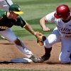 Oklahoma\'s Kolbey Carpenter (23) is safe beating the tag of Baylor\'s Hayden Ross (45) as the University of Oklahoma Sooner (OU) baseball team plays the Baylor Bears in college baeball at L. Dale Mitchell Park on May 3, 2014 in Norman, Okla. Photo by Steve Sisney, The Oklahoman