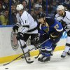 Photo - St. Louis Blues' Alex Pietrangelo (27) gets the puck past Los Angeles Kings' Anze Kopitar (11), of Slovenia, and Jeff Carter (77) during the first period of an NHL hockey game on Thursday, Jan. 2, 2014, in St. Louis. (AP Photo/Bill Boyce)