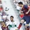 Barcelona\'s Lionel Messi from Argentina, right, heads the ball past Elche\'s Ruben Perez del Marmol during a Spanish La Liga soccer match at the Martinez Valero stadium in Elche, Spain, on Sunday, May 11, 2014.(AP Photo/Alberto Saiz)