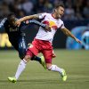 Photo - New York Red Bulls' Armando, right, of Spain, reacts as he tackles Vancouver Whitecaps' Darren Mattocks, of Jamaica, during first half MLS soccer action in Vancouver, B.C., on Saturday March 8, 2014.   (AP Photo/The Canadian Press, Darryl Dyck)