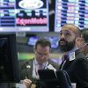 Photo -   Specialist Fabian Caceres works at his post on the floor of the New York Stock Exchange Tuesday, Oct. 9, 2012. Another dire prediction about global economic growth is sending stocks lower on Wall Street in early trading. (AP Photo/Richard Drew)