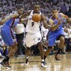 Memphis Grizzlies guard Tony Allen (9) steals the ball away from Oklahoma City Thunder forward Kevin Durant, left, and Thabo Sefolosha (2), of Switzerland, during the first half of Game 6 of a second-round NBA basketball playoff series on Friday, May 13, 2011, in Memphis, Tenn. (AP Photo/Wade Payne)