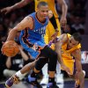 Oklahoma City\'s Russell Westbrook (0) tracks down a loose ball as Los Angeles\' Ramon Sessions (7) defends during Game 4 in the second round of the NBA basketball playoffs between the L.A. Lakers and the Oklahoma City Thunder at the Staples Center in Los Angeles, Saturday, May 19, 2012. Photo by Nate Billings, The Oklahoman