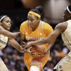 Tennessee guard Ariel Massengale, center, drives between Vanderbilt\'s Christina Foggie (10) and Tiffany Clarke (34) during the first half of an NCAA college basketball game, Thursday, Jan. 24, 2013, in Nashville, Tenn. (AP Photo/Mark Humphrey)