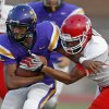Northwest Classen\'s Jalen Harris runs past Western Heights\' Davonte Drennan during a high school football game at Taft Stadium in Oklahoma City, Thursday, September 20, 2012. Photo by Bryan Terry, The Oklahoman