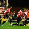 Sunderland\'s James McClean, right, celebrates his goal with his teammates during their English Premier League soccer match against Reading at the Stadium of Light, Sunderland, England, Tuesday, Dec. 11, 2012. (AP Photo/Scott Heppell)