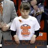 An Oklahoma State fan shows her support with a banner during the memorial service for Oklahoma State head basketball coach Kurt Budke and assistant coach Miranda Serna at Gallagher-Iba Arena on Monday, Nov. 21, 2011 in Stillwater, Okla. The two were killed in a plane crash along with former state senator Olin Branstetter and his wife Paula while on a recruiting trip in central Arkansas last Thursday. Photo by Chris Landsberger, The Oklahoman