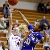 Edmond Memorial\'s Alyssa Hand, left, puts up a shot beside Choctaw\'s Sydney Wyatt during the Class 6A girls basketball regional championship game at Edmond Memorial High School, Saturday, Feb. 25, 2012. Photo By Bryan Terry, The Oklahoman
