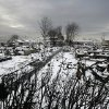 The fire-scorched landscape of Breezy Point is shown after a Nor\'easter snow, Thursday, Nov. 8, 2012 in New York. The beachfront neighborhood was devastated during Superstorm Sandy when a fire pushed by the raging winds destroyed many homes. (AP Photo/Mark Lennihan) ORG XMIT: NYML104