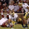 Notre Dame\'s Manti Te\'o (5), center, and Stephon Tuitt (7) stand over OU\'s Landry Jones (12) after a sack during the college football game between the University of Oklahoma Sooners (OU) and the Notre Dame Fighting Irish at Gaylord Family-Oklahoma Memorial Stadium in Norman, Okla., Saturday, Oct. 27, 2012. Photo by Bryan Terry, The Oklahoman