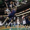 Detroit Pistons\' Kyle Singler (25) loses control of the ball in front of Boston Celtics\' Chris Johnson (12) in the first quarter of an NBA basketball game in Boston, Sunday, March 9, 2014. (AP Photo/Michael Dwyer)