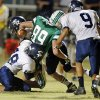 El Reno\'s Josh Robinson, behind, jars the ball lose from McGuinness\' David Love as the Indians play the Bishop McGuinness Fighting Irish in high school football on Friday, Sept. 21, 2012 in Oklahoma City, Okla. McGuinness recovered the ball. Photo by Steve Sisney, The Oklahoman