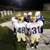 Kingfisher and Millwood huddle up a midfield before the Class 2A State semifinal football game between Millwood High School and Kingfisher High School on Saturday, Dec. 5, 2009, in Yukon, Okla. Photo by Chris Landsberger, The Oklahoman