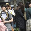 Photo - Fans of Paul McCartney gather outside of a hotel believed to be stayed by McCartney in Tokyo, Tuesday, May 20, 2014. The former Beatle is canceling his entire Japan tour because of illness including the one set for Wednesday at Nippon Budokan hall, where The Beatles performed during their first Japan tour in 1966. (AP Photo/Eugene Hoshiko)