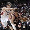Chicago Bulls\' Kirk Hinrich (12) drives around Houston Rockets\' Omer Asik (3) as Jeremy Lin watches from behind in the first half of an NBA basketball game Wednesday, Nov. 21, 2012, in Houston. (AP Photo/Pat Sullivan)