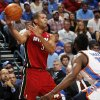 Miami\'s Shane Battier (31) passes the ball as Oklahoma City\'s James Harden (13) defends during the NBA basketball game between the Miami Heat and the Oklahoma City Thunder at Chesapeake Energy Arena in Oklahoma City, Sunday, March 25, 2012. Photo by Nate Billings, The Oklahoman