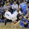 New Orleans Hornets guard Chris Paul (3) falls to the court after stealing the ball from Oklahoma City Thunder guard Russell Westbrook (0) as Thunder forward Nick Collison (4) falls to the floor late in the second half of an NBA basketball game in New Orleans, Monday, Jan. 24, 2011. This steal gave the ball to the Hornets, allowing David West to make the game winning shot. The Hornets defeated the Thunder 91-89. (AP Photo/Bill Haber)
