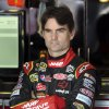 Photo -   Driver Jeff Gordon waits before practice for Saturday's NASCAR Bank of America 500 Sprint Cup series auto race in Concord, N.C., Friday, Oct. 12, 2012. (AP Photo/Bob Jordan)