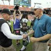 Photo - New York Jets head coach Rex Ryan, left, shakes hands with Miami Dolphins head coach Joe Philbin after the Jets defeated the Dolphins 20-7 in an NFL football game Sunday, Dec. 29, 2013, in Miami Gardens, Fla. (AP Photo/Chris O'Meara)