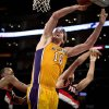 Los Angeles Lakers forward Pau Gasol, middle, attempts a shot against Portland Trail Blazers center Marcus Camby, left, and forward Nicolas Batum during the first half of an NBA basketball game, Monday, Feb. 20, 2012, in Los Angeles. (AP Photo/Bret Hartman)