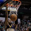 Photo - Indiana Pacers guard Paul George (24) dunks the ball in the first half during an NBA basketball game against the Utah Jazz, Saturday, Jan. 26, 2013, in Salt Lake City. (AP Photo/Steve C. Wilson)