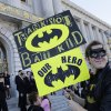 John Ewing waits outside of City Hall for the Batkid, Miles Scott, 5, to make an appearance at a rally in San Francisco on Friday, Nov. 15, 2013. Miles is a leukemia survivor from Tulelake in Siskiyou County. After battling leukemia since he was a year old, Miles is now in remission. One of his heroes is Batman. To celebrate the end of this treatment, the Make-A-Wish Greater Bay Area granted his wish to become Batkid for a day. (AP Photo/Bay Area News Group, Gary Reyes)