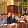Photo -  OU linebacker Eric Striker, right, eats with fellow students during a