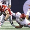 Oklahoma\'s Travis Lewis (28) brings down Nebraska\'s Mike McNeill (44) during the Big 12 football championship game between the University of Oklahoma Sooners (OU) and the University of Nebraska Cornhuskers (NU) at Cowboys Stadium on Saturday, Dec. 4, 2010, in Arlington, Texas. Photo by Chris Landsberger, The Oklahoman