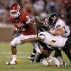Oklahoma\'s Brennan Clay (3) runs past Missouri\'s Matt White, center, and Luke Lambert, right, during their game Saturday in Norman. Photo by Bryan Terry, The Oklahoman