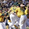 The Oakland Athletics celebrate their 12-5 win over the Texas Rangers in a baseball game, Wednesday, Oct. 3, 2012 in Oakland, Calif. The A\'s clinch the AL West title with the win. (AP Photo/Ben Margot)