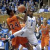 Duke\'s Elizabeth Williams (1) and Virginia Tech\'s Taijah Campbell (24) reach for a rebound during the first half of an NCAA college basketball game in Durham, N.C., Wednesday, Jan. 16, 2013. Duke won 58-26. (AP Photo/Gerry Broome)