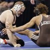 Oklahoma State\'s Chris Perry takes on Lehigh\' s Elliot Riddick in the 174 pound match during the 2014 NCAA Div. 1 Wrestling Championships at Chesapeake Energy Arena in Oklahoma City, Okla. on Friday, March 21, 2014. Photo by Chris Landsberger, The Oklahoman