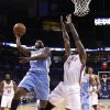 Oklahoma City\'s Kendrick Perkins (5) defends against Denver\'s Ty Lawson (3) during the first round NBA basketball playoff game between the Oklahoma City Thunder and the Denver Nuggets on Wednesday, April 20, 2011, at the Oklahoma City Arena. Photo by Sarah Phipps, The Oklahoman